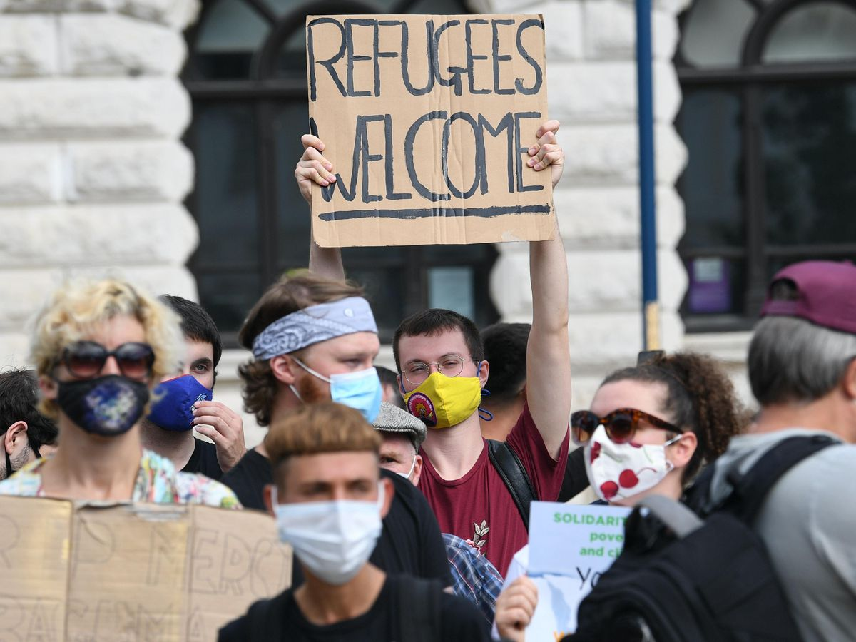 Pro-migrant supporters during a 'solidarity stand' in Dover's Market Square