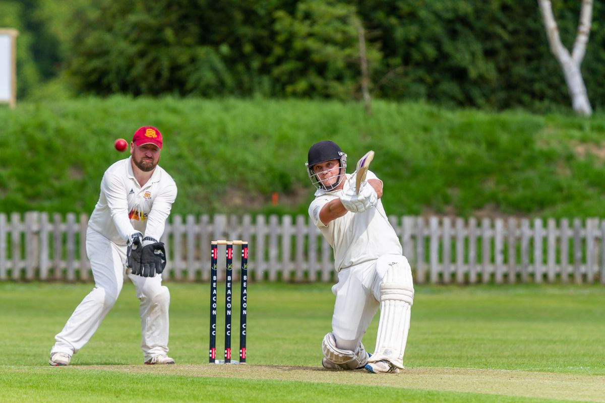Oliver Green flays the bowling on his way to 68 not out during Beacon's huge victory over Rugeley in the South Staffs Cricket League