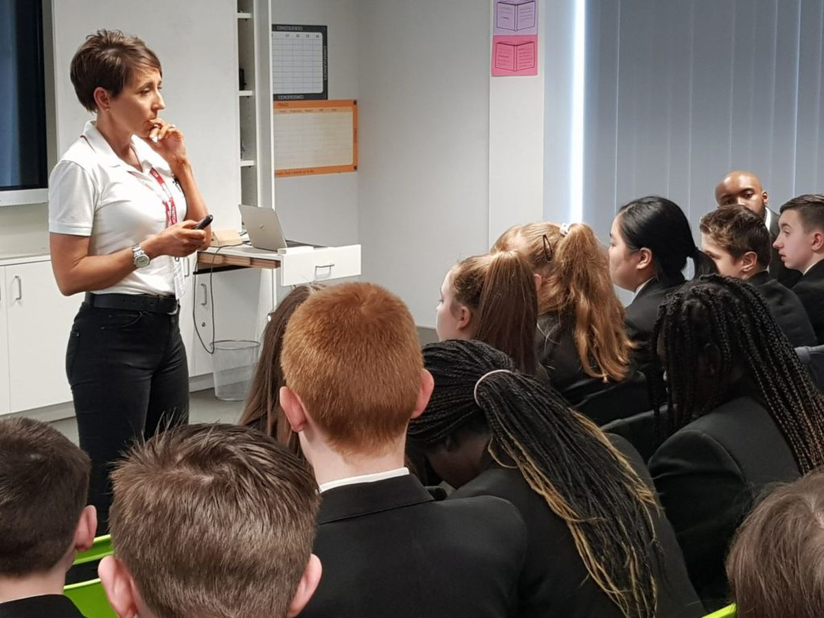 Natalie Queiroz speaks to pupils at Our Lady and St Chad's School