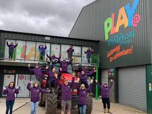 Staff celebrate the opening of the new play barn at Lower Drayton Farm