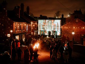 The main street lit up in the Black Country Living Museum town