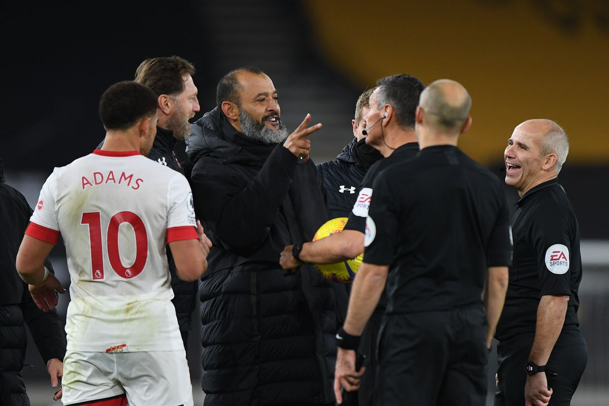 Nuno Espirito Santo the head coach / manager of Wolverhampton Wanderers and Referee Andre Marriner at full time (AMA)