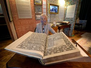 House volunteer Ruth Vyse with the 125-year old copy of The Works of Geoffrey Chaucer