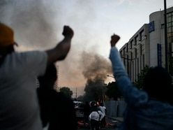 Paris police fire tear gas as George Floyd protests go global