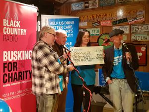The cheque presentation with Billy Spakemon