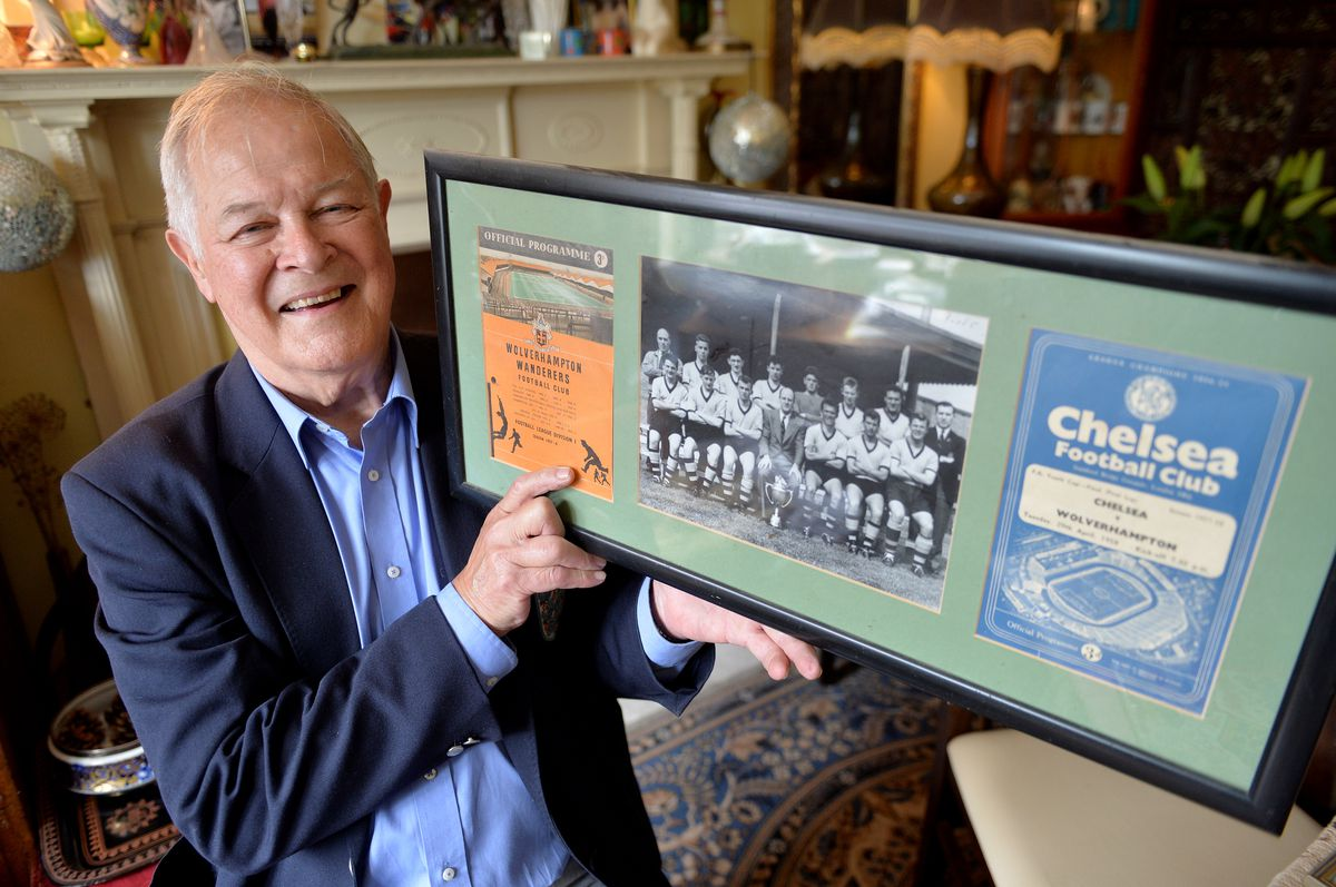 Ted Farmer with an old photograph of the Youth Cup winning team and match programmes from Wolves and Chelsea of the final