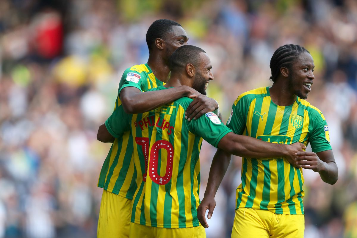 Matt Phillips of West Bromwich Albion celebrates after scoring a goal to make it 1-2 with Semi Ajayi of West Bromwich Albion and Romaine Sawyers of West Bromwich Albion. (AMA)