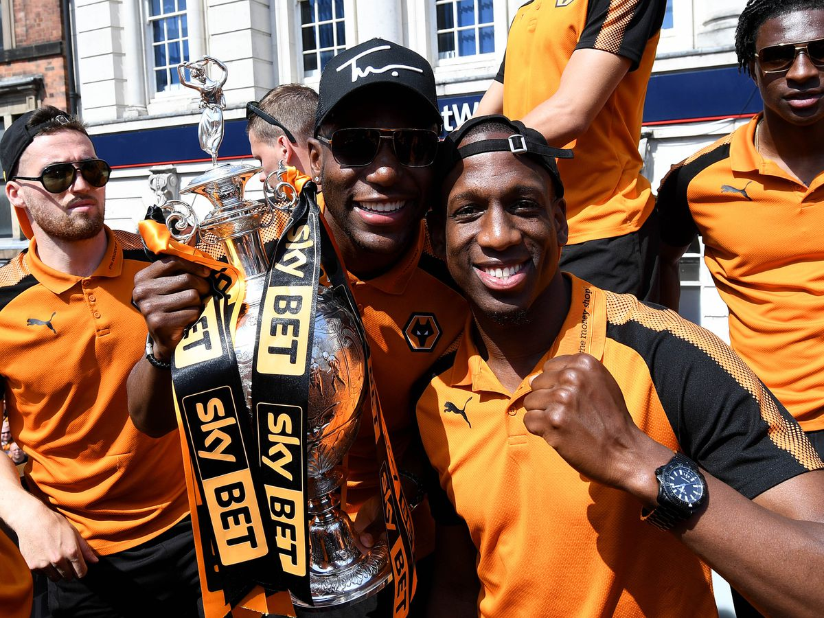 Benik Afobe and Willy Boly pose with the Championship title (AMA)
