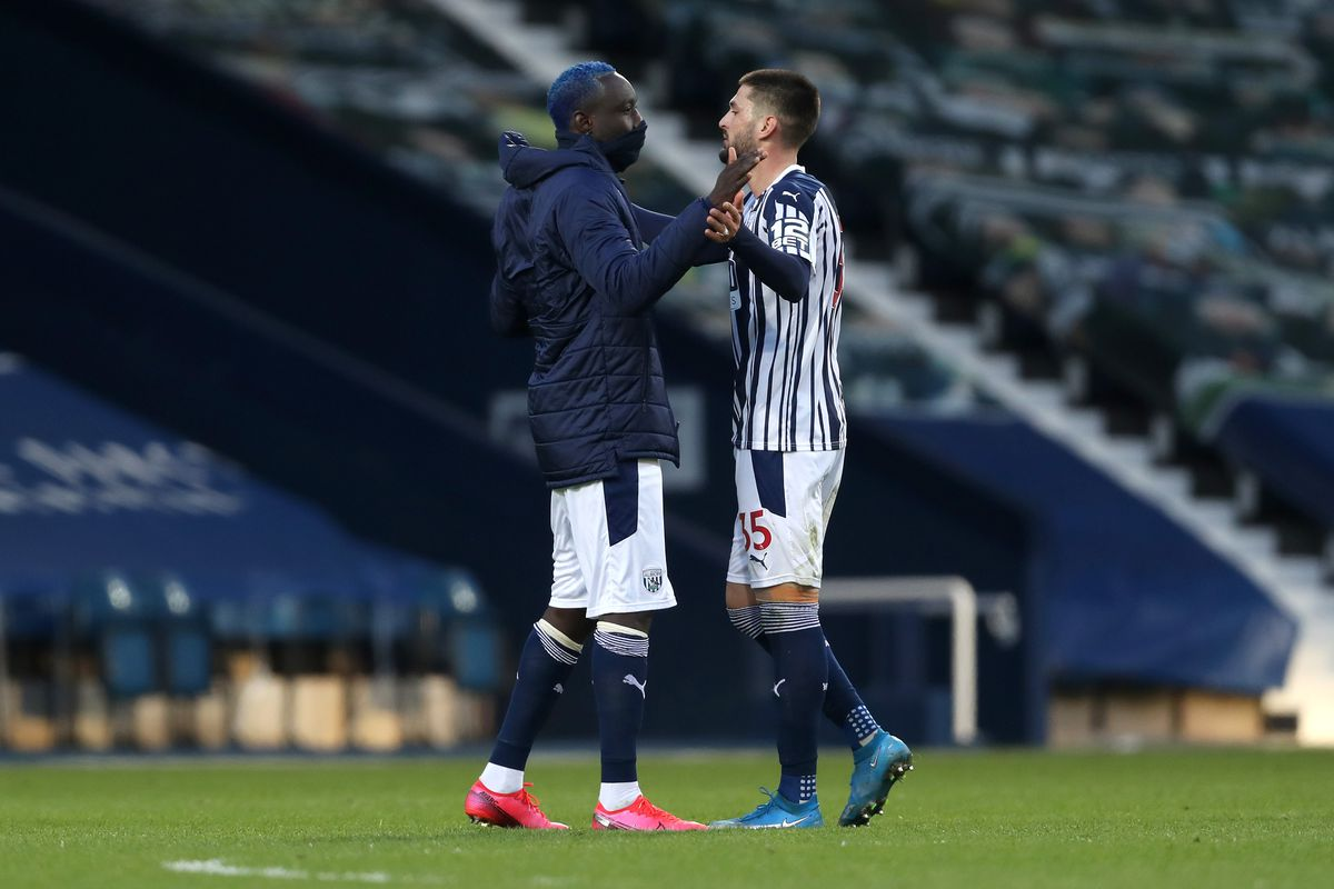 Substituted Mbaye Diagne of West Bromwich Albion comes onto the pitch after the final whistle to celebrate with Okay Yokuslu. (AMA)