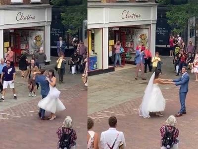 Newlyweds enjoy impromptu street dance thanks to quick-thinking busker