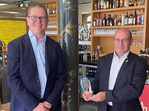 Nigel Marriott, right, owner director at trebles, receives the supplier of the year award from J S Wright national design and estimating director Andrew Smith