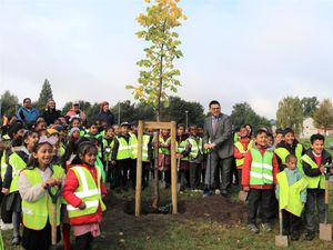 Councillor Waseem Zaffar planting trees with children on the Sprint line