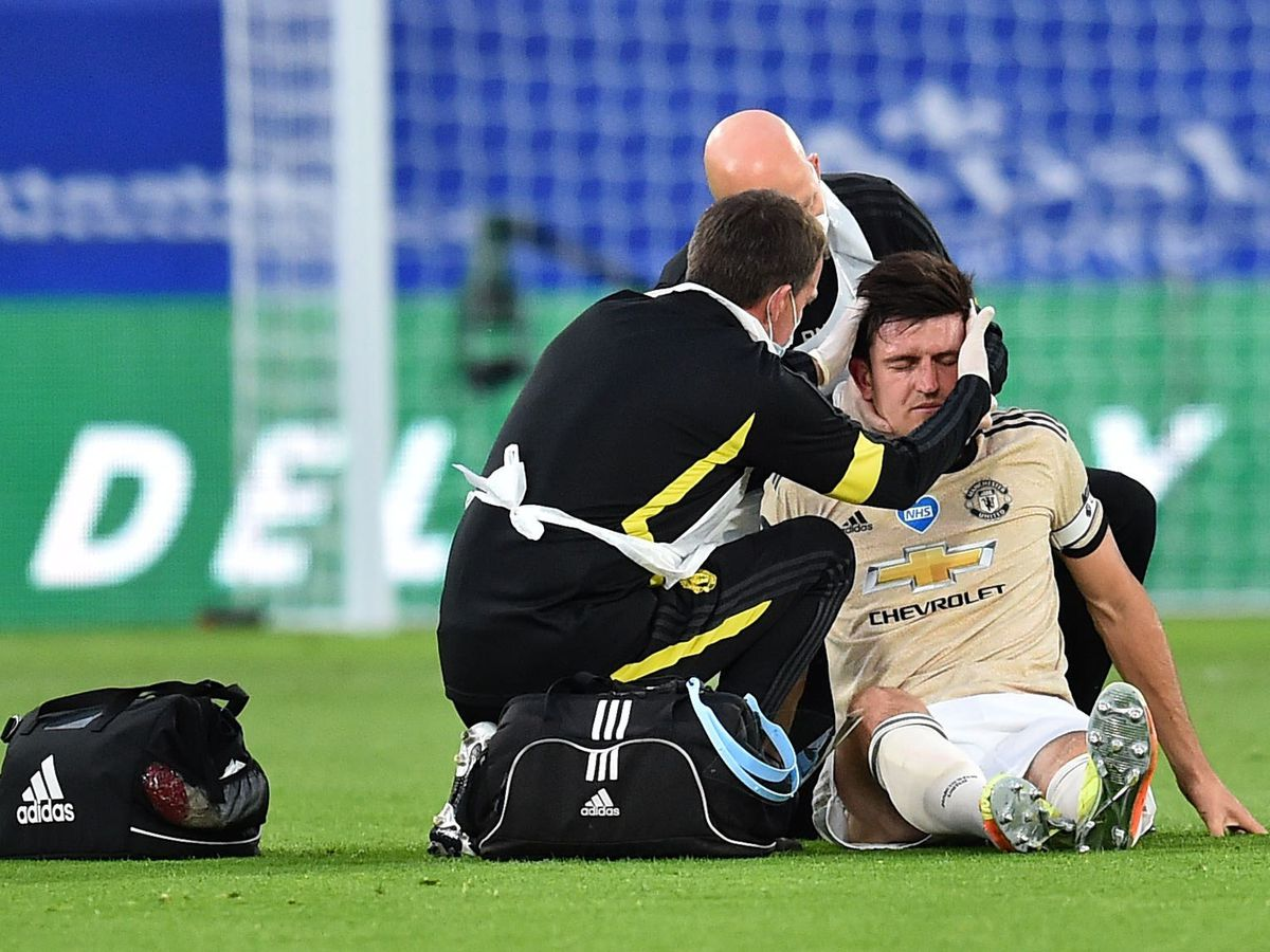 Manchester United's Harry Maguire receives treatment for a head and neck injury on the pitch during a match against Crystal Palace
