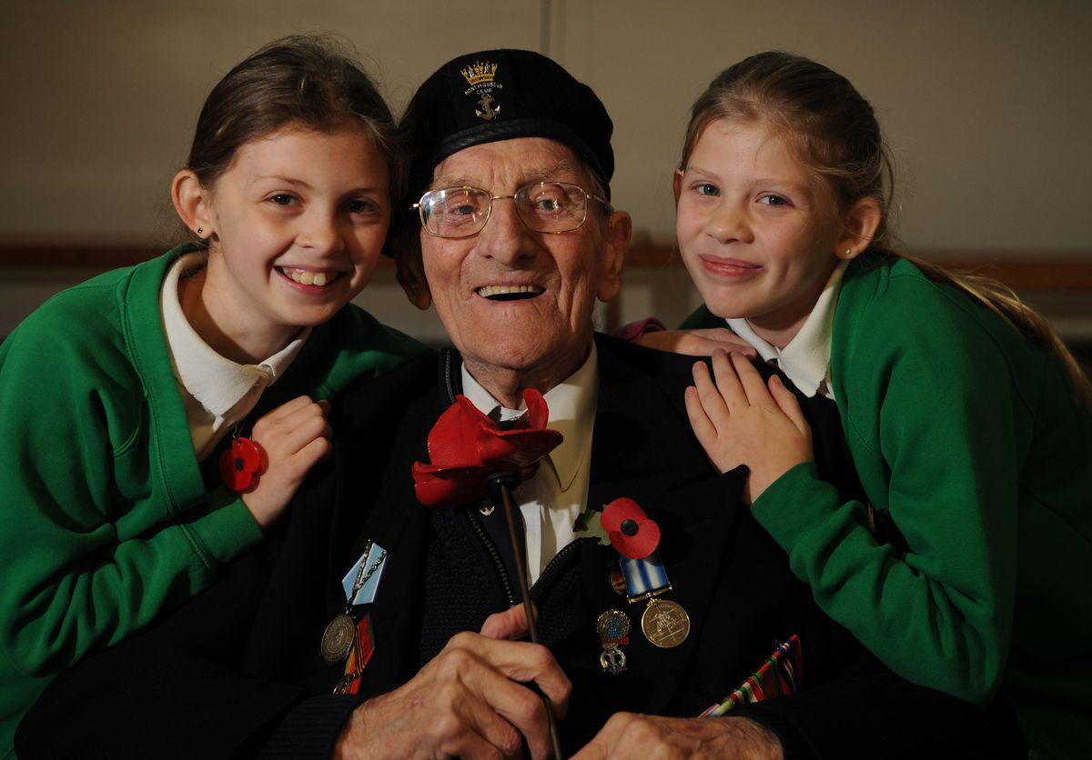 William Harry Busby with his great granddaughters, pupils Gabriella Zangaro, 9, and Luciana Zangaro, 11, during his visit