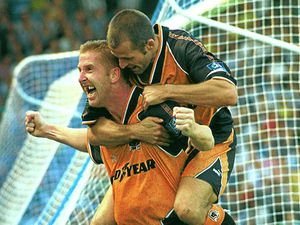Iwan Roberts celebrates his third goal with fellow scorer Steve Bull on his back.