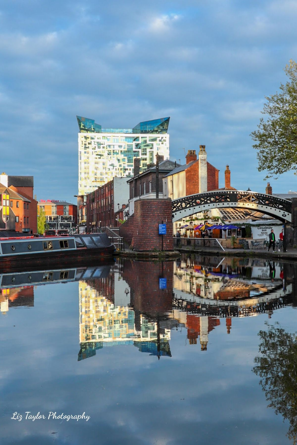 The Cube make a stiking addition to the skyline and is reflected in the canal in Birmingham. Photo by Liz Taylor