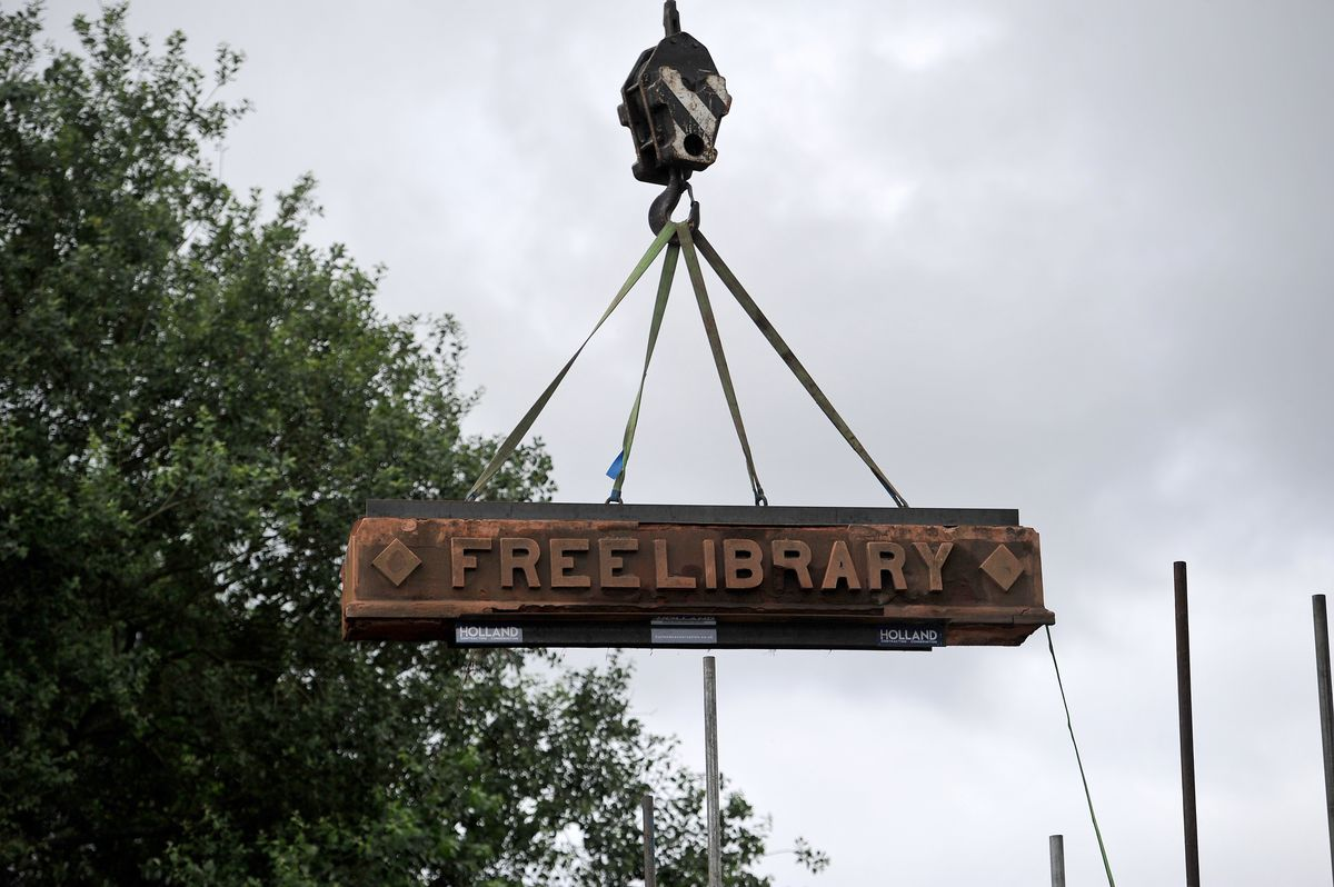The library stone, which was the hardest part to remove, and the most iconic part of the building, is lifted out of place