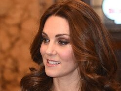 Pregnant Kate dazzles at Royal Variety Performance despite police incident