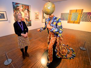 Head curator Carol Thompson views a piece called Earth by Yinka Shonibare