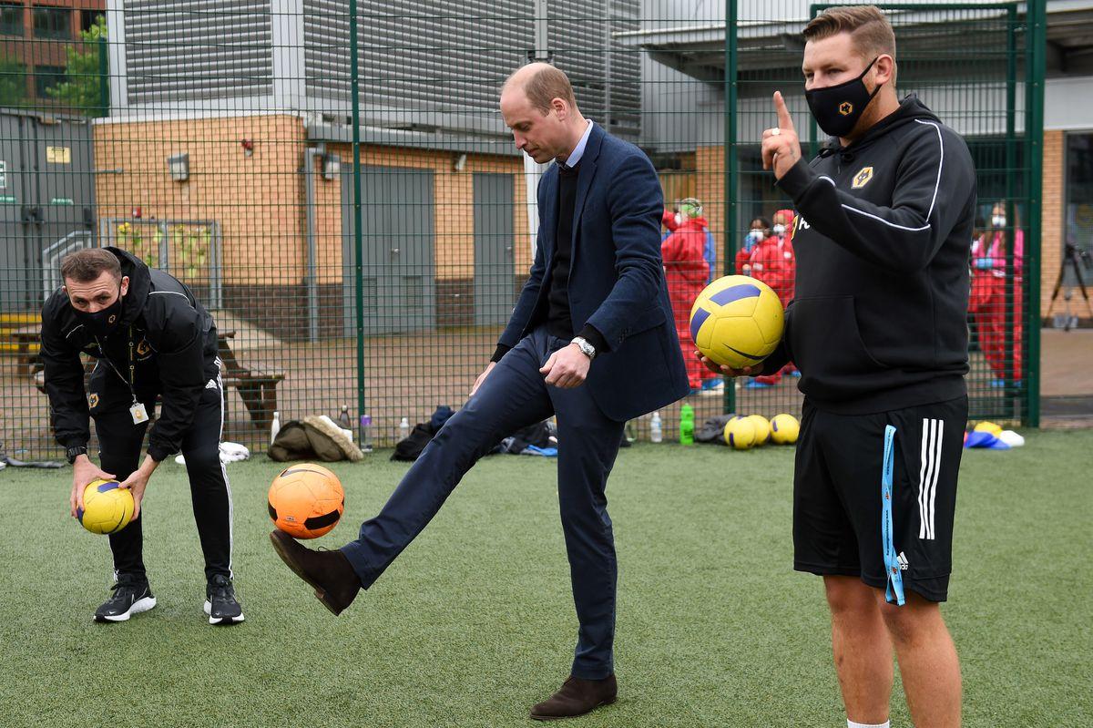 The Duke of Cambridge kicking a football at The Way Youth Zone