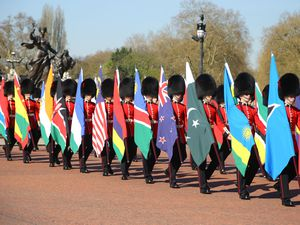 The Queen's Guard carrying the flags of some of the Commonwealth countries
