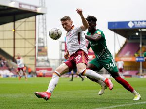 """Bradford City's Caolan Lavery (left) and Walsall's Rollin Menayese battle for the ball during the Sky Bet League Two match at the Utilita Energy Stadium, Bradford. Picture date: Saturday September 4, 2021. PA Photo. See PA story SOCCER Bradford. Photo credit should read: Zac Goodwin/PA Wire. ..RESTRICTIONS: EDITORIAL USE ONLY No use with unauthorised audio, video, data, fixture lists, club/league logos or """"live"""" services. Online in-match use limited to 120 images, no video emulation. No use in betting, games or single club/league/player publications.."""
