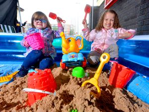 Bonnie Hunt and Skyla Lewis have fun on the makeshift beach at Hope Community Project