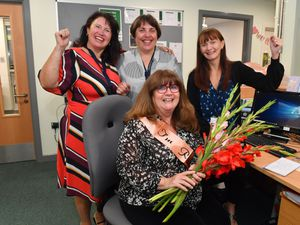 LICHFIELD COPYRIGHT MNA MEDIA TIM THURSFIELD 30/09/21 .Receptionist Kate Kirman, is pictured with colleagues Lisa Mason, Jo Critchley and Laura Smith-Jones at King Edward Vl School, Lichfield, as she retires after 22 years of service..