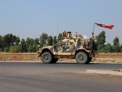 US troops leaving Syria 'cannot stay in Iraq'