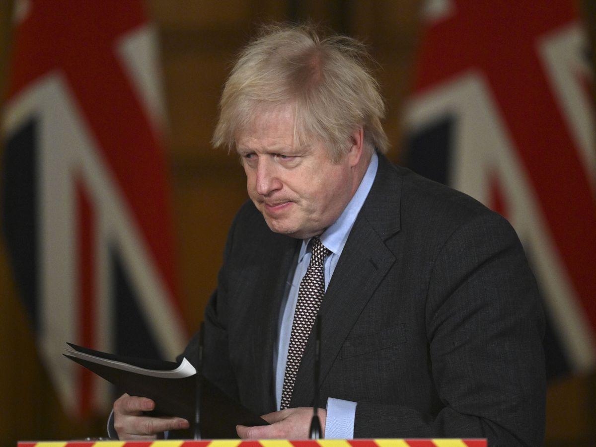 Prime Minister Boris Johnson leaves the podium following a media briefing in Downing Street on coronavirus