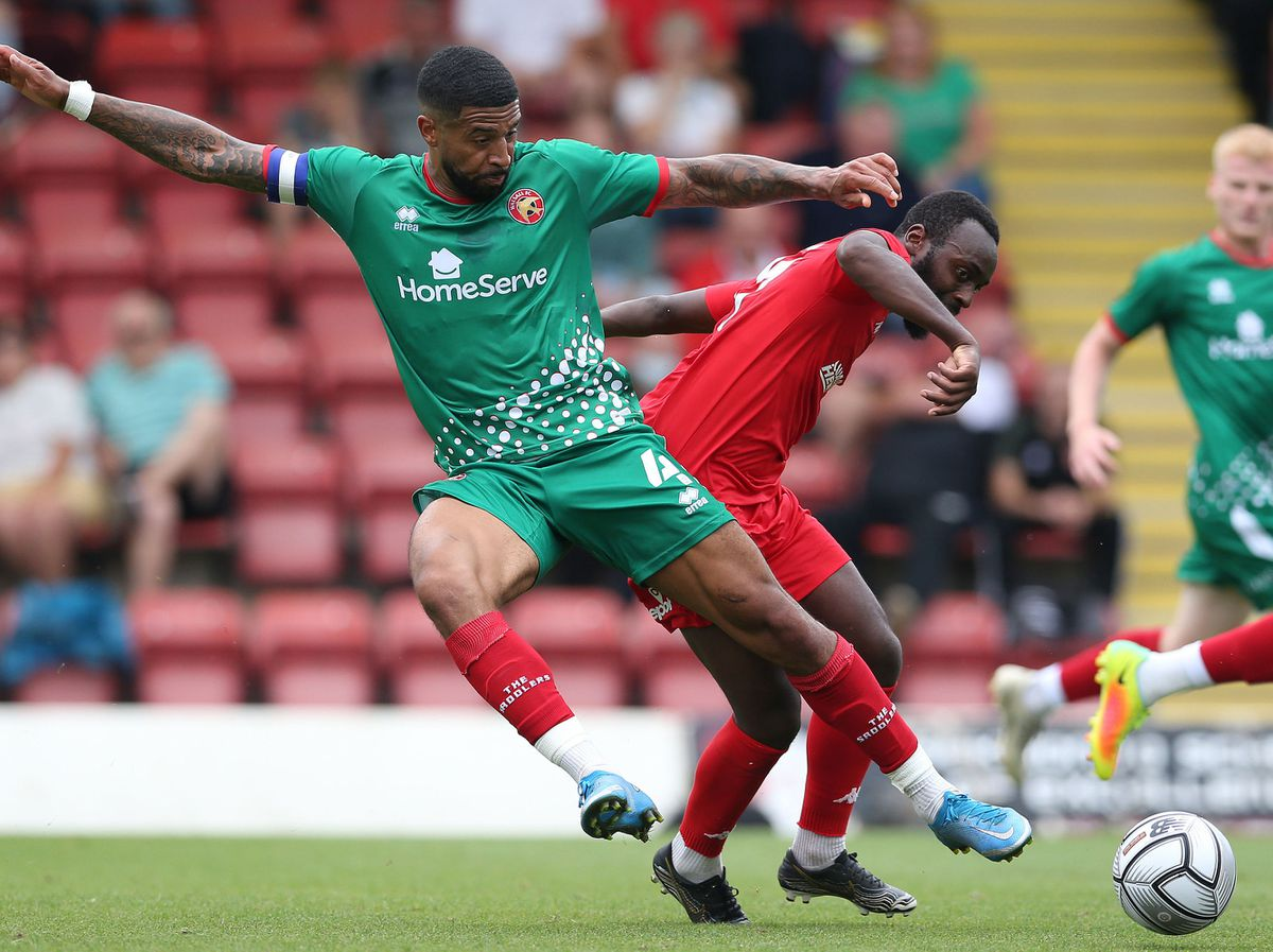 Kidderminster Harriers' Omari Sterling (right) and Walsall's Joss Labadie battle for the ball