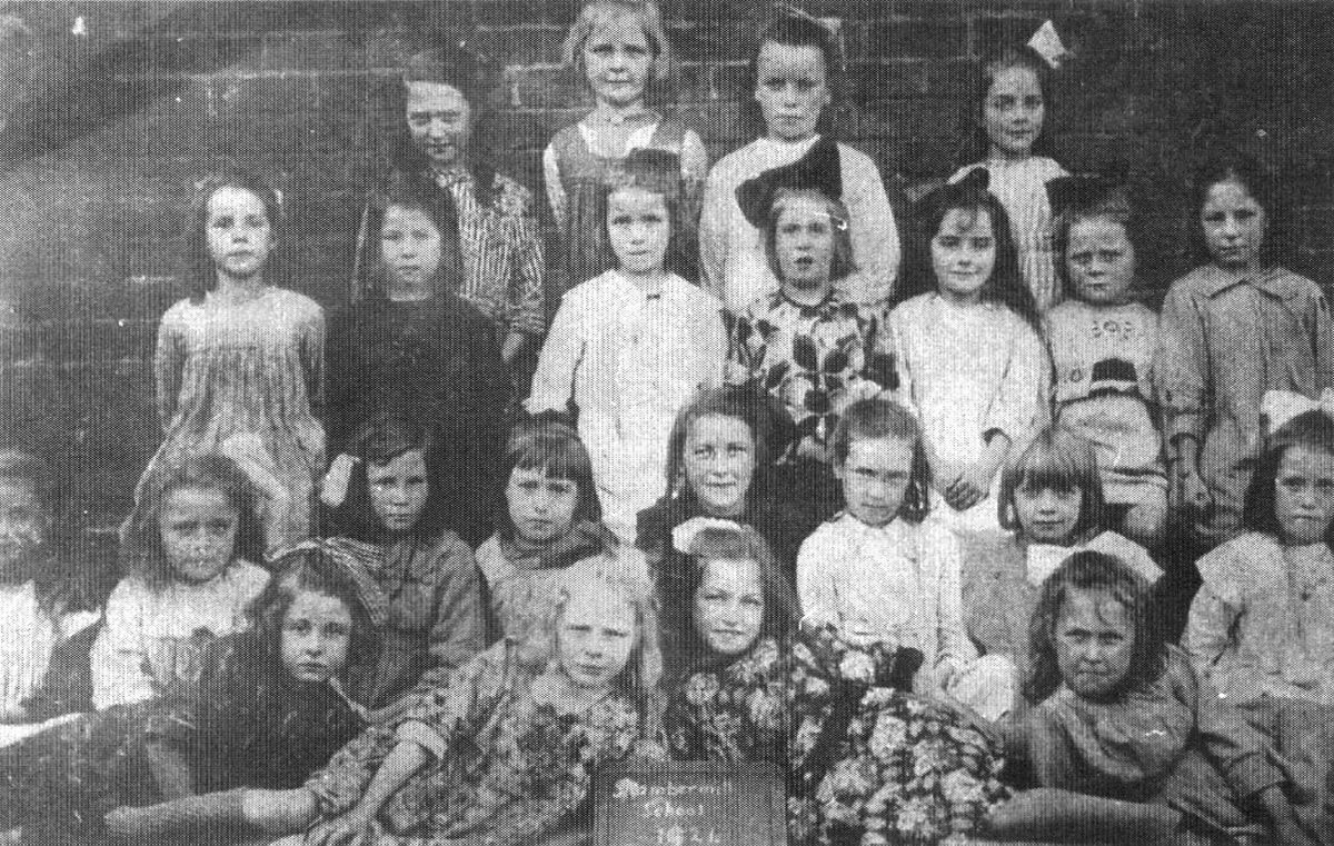 Seven-year-old Ellen, back row, right, at Stambermill Junior School in 1921