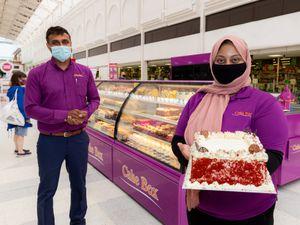 Tejinder Singh, left, and Farhana Akhtar at the Cake Box opening