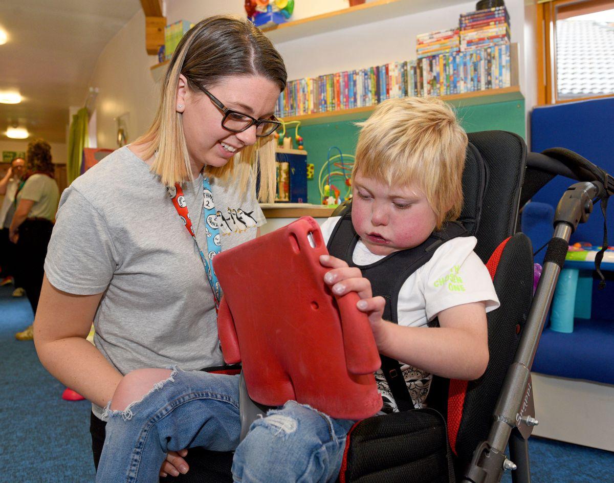 Staff nurse Beth Parker with nine-year-old Mason Williams