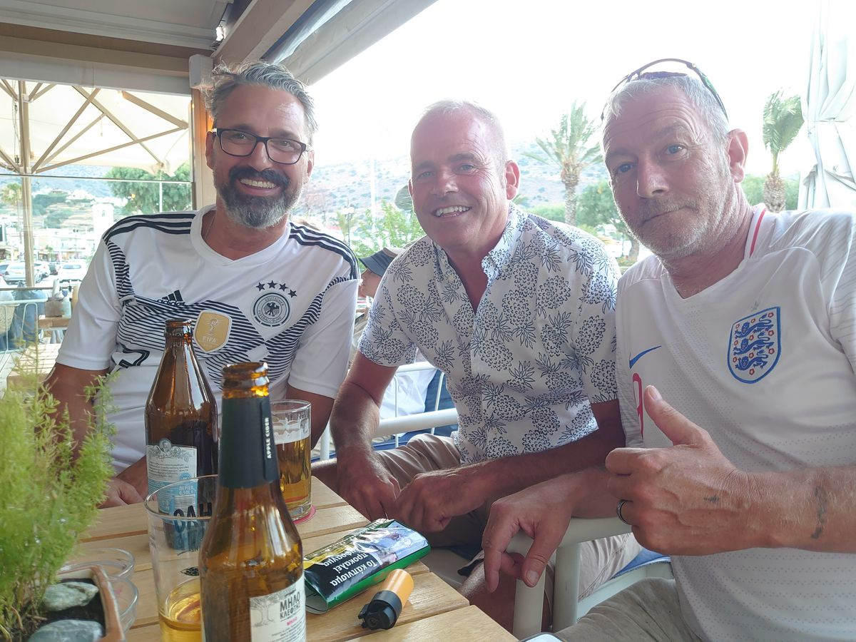 Watching in Crete is Brierley Hill ex pat and Wolves fan Mark Pritchard, centre, with German friend Stefan, left, and fellow Wolves fan Colin from Newmarket, right