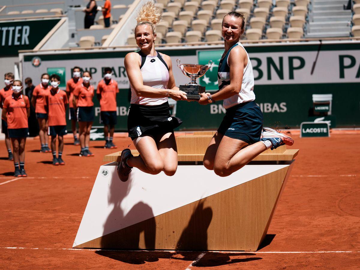 Barbora Krejcikova, right, and Katerina Siniakova do a celebratory leap