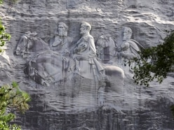 Armed protesters call for removal of giant Confederate carving