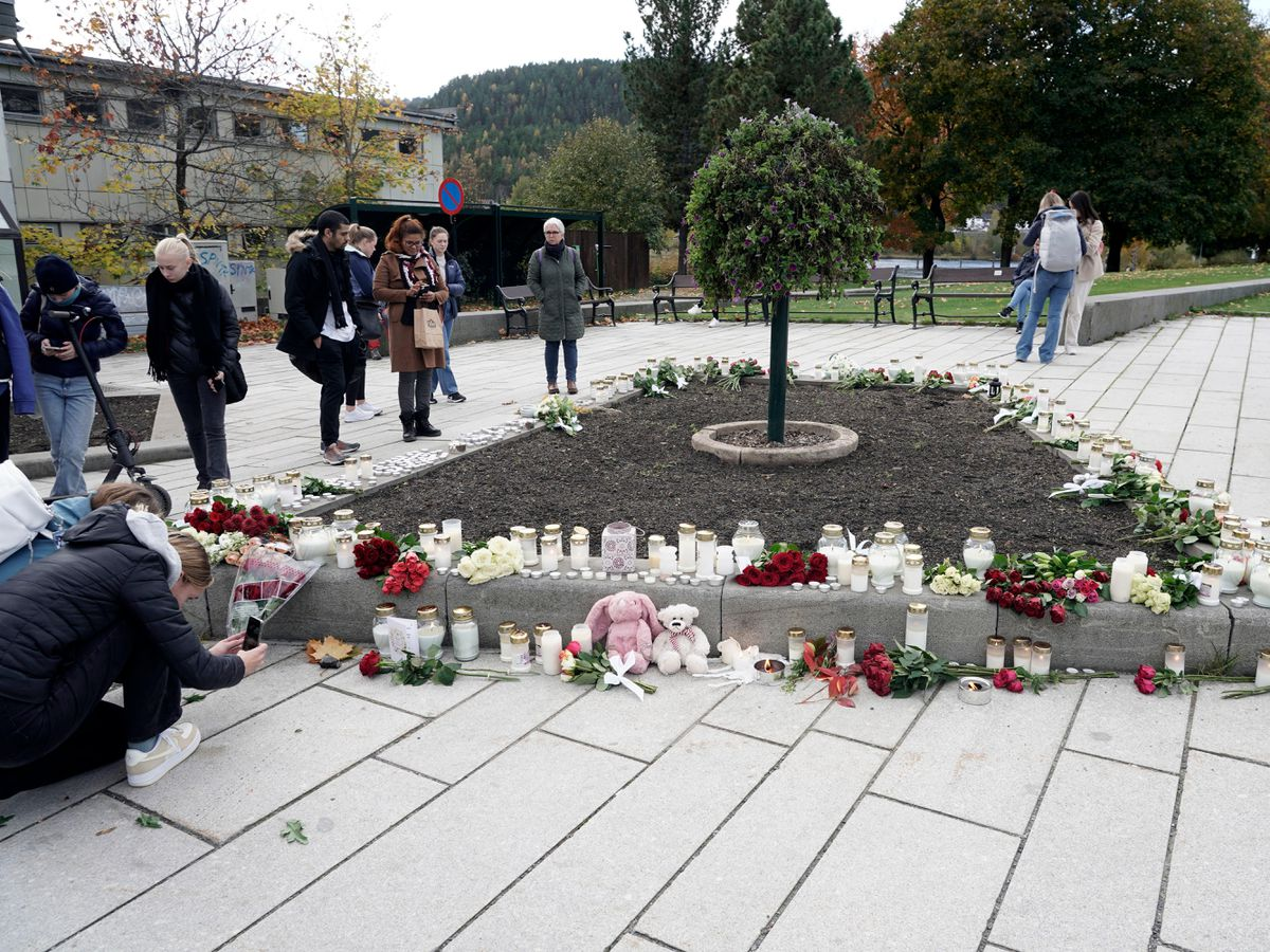 Flowers and candles are left after the attack in Norway