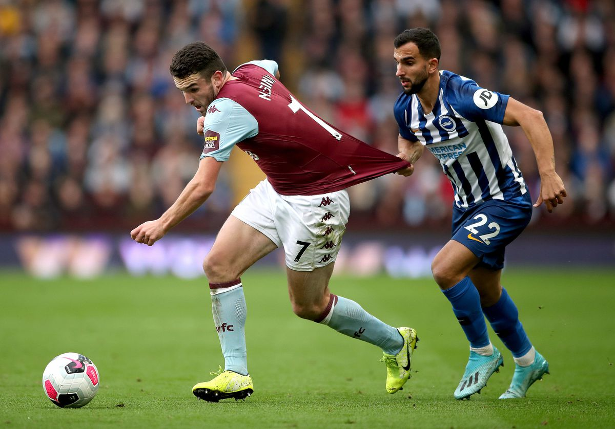 Brighton and Hove Albion's Martin Montoya (right) fouls Aston Villa's John McGinn