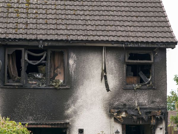 The house was devastated by the fire. Photo: Steve Parsons/PA Wire