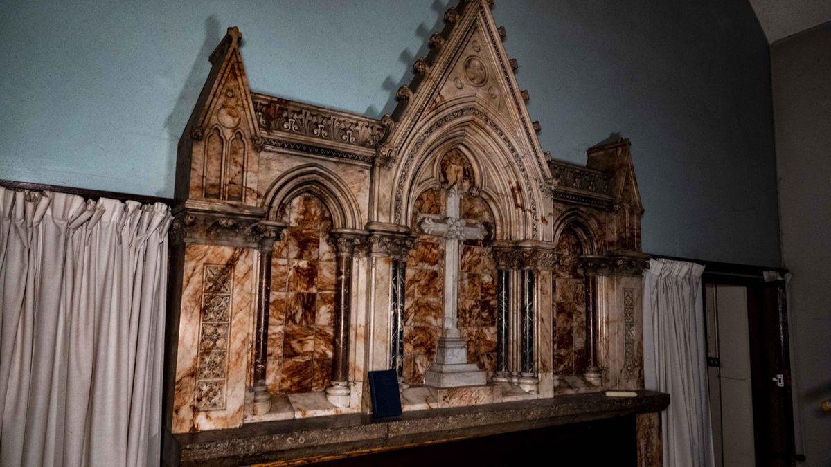 The run down location has chipped paint, wall paper, and more - as well as an impressive church