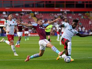 """Aston Villa's Frederic Guilbert (left) and Walsall's Rollin Menayese battle for the ball during the pre-season friendly match at Banks's Stadium, Walsall. Picture date: Wednesday July 21, 2021. PA Photo. See PA story SOCCER Walsall. Photo credit should read: Tim Goode/PA Wire. ..RESTRICTIONS: EDITORIAL USE ONLY No use with unauthorised audio, video, data, fixture lists, club/league logos or """"live"""" services. Online in-match use limited to 120 images, no video emulation. No use in betting, games or single club/league/player publications.."""
