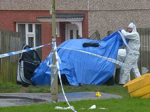 A car crashed into a fence in the aftermath of the violence in Brierley Hill