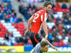 Former Walsall striker Will Grigg hopes his old side stay up