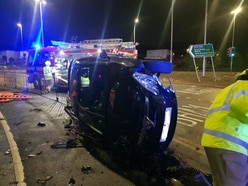 Driver and passenger unhurt as car flips onto its side in Dudley crash