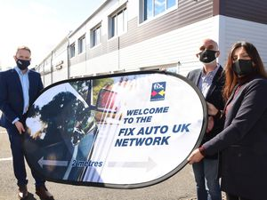Caption: Fix Auto UK's 109th franchise partner Fix Auto Oldbury joins the network. Martin Willis, Fix Auto UK's Business Development Manager (left), welcomes Harvey Mann and his wife Kam to the network.