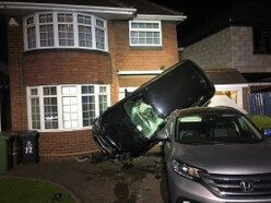 Car flips into Pelsall house in dramatic crash