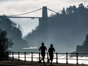 Joggers exercising along the River Avon in Bristol