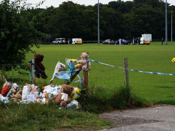Tributes left at the scene in the Sarn area of Bridgend,