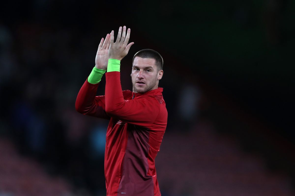 Albion's Sam Johnstone applauds the travelling fans at Bournemouth (AMA)